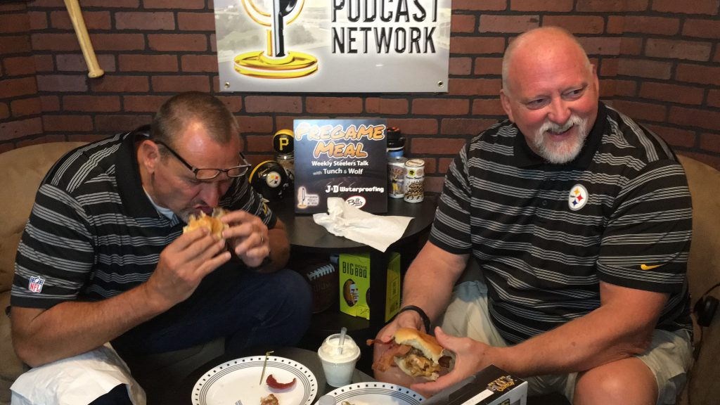Tunch & Wolf are enjoying the Tunch & Wolf Burger - available at Bill's Bar & Burger